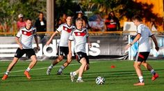 Bastian Schweinsteiger (C) plays the ball during the German National team training session