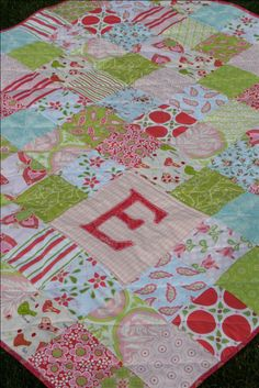 Elsie's quilt - love the idea of just the baby's initial on the quilt instead of their full first name.