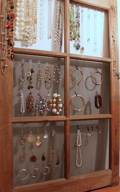hanging jewelry on S-hooks on a screened window