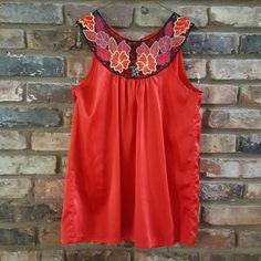 Red boho blouse by POETRY Selling a unique red boho blouse. Lightweight and flowy. Shoulder and chest area are intricately crocheted with a beautiful floral pattern. Back is closed with a tie. I love this blouse but rarely wear it. Hopefully it can find a good home! Enjoy!  Selling on ♏ for $11 Poetry Tops