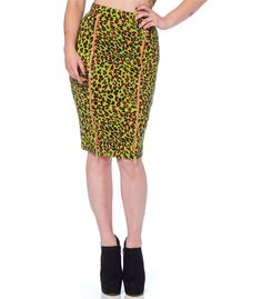 "This bad skirt comes in our favorite vomit green hue. It is a fantastic figure-hugging eclectic piece with an exotic leopard print and two zips that fasten down the front. Bring the animal inside you to life!  Neon green pencil skirt Exotic leopard print throughout Two front zips Waistband Knee-length  Style advice: Cut close to body Fabric: 95% cotton, 5% elastane  Small:  Waist 26""  Hips 33-35""Med:    Waist 28""  Hips 35-37""Lrg:      Waist 30""  Hips 37-39""XLrg:   Waist 32""  Hips…"
