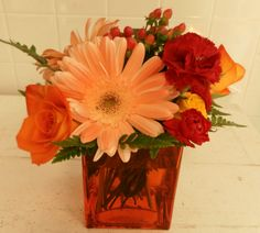 """Gorgeous """"Tequila Sunrise"""" arrangement with light orange Gerber daisies, tangerine roses and coffee berries!"""
