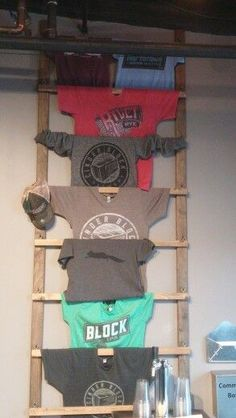 Beer apparel ladder – in 2020 (With images) Brewery Decor, Brewery Design, Zero Waste Shop, Clothing Store Displays, Craft Show Displays, Store Fixtures, Tap Room, Retail Space, Merchandising Displays