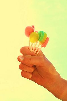 lollipop hands sweets childhood. Our childhoods never really leave us. We never let go of the children in us.