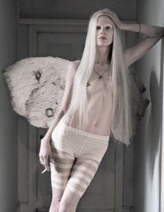 Kristen McMenamy plays a winged creature in 'The Origin Of Monsters' by Tim Walker for LOVE S/S 2012