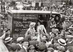 "New York, August 1913.  ""Suffragettes on way to Boston."" The ""suffrage caravan"" campaign for women's voting rights, seems to have drawn quite a crowd."