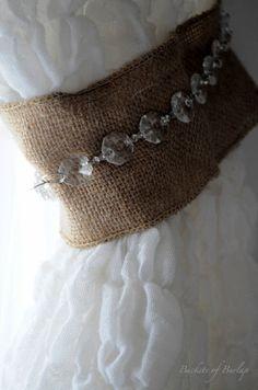 Linen and crystal bead trim tiebacks secure crisp white natural sheer drapery. Great texture.