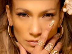 """JENNIFER LOPEZ'S RINGS """"In her newest music video, she keeps flashing her rings in front of her face. Now I can't stop thinking about them."""" – Dana  JLo loves her some flashy style, and these jewels are no exception. You can get your own Effy """"D'oro"""" 18-carat yellow gold diamond ring, Graziela """"Yellow Couture Wave ring"""" and EF Collection """"Diamond Triple Spiral ring"""""""