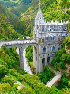 Las Lajas Cathedral The gorgeous gothic-inspired Las Lajas Cathedral was built near the border between Colombia and Ecuador in a teeming jungle canyon. The church stands on stone stilts spanning a. Beautiful Castles, Beautiful Buildings, Beautiful Places, Places Around The World, The Places Youll Go, Around The Worlds, Foto Poster, Medieval Castle, Fantasy Landscape