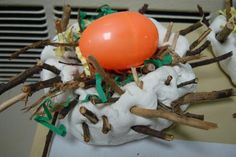 Using play dough and twigs to make a nest......I think the preschoolers would love this!