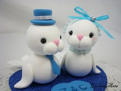 Custom Love Seal Couple Wedding Cake Topper with Heart Base - SPECIAL  FOR 2012. $55.00, via Etsy.