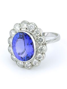 Tanzanite Diamond Gold Cluster Ring | From a unique collection of vintage cluster rings at https://www.1stdibs.com/jewelry/rings/cluster-rings/