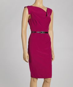 A striking belted waist adds extra fashionable interest to this clean, formfitting dress. With a draping surplice neckline and subtle seam details, it is the perfect blend of bold and elegant.Measurements (size 6): 39'' long from high point of shoulder to hem82% polyester / 15% rayon / 3% spandexMachine wash