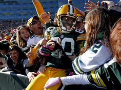 Green Bay Packers wide receiver Donald Driver celebrates a touchdown after doing a Lambeau Leap during the second half of an NFL football game against the Jacksonville Jaguars, Sunday, Oct. in Green Bay, Wis. The Packers won Nfl Football Games, Packers Football, Football Helmets, Football Boys, Football Cards, Green Bay Football, Nfl Green Bay, Greenbay Packers, Donald Driver