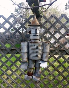 Learn to make a Tin Man out of recycled cans for your yard or garden.
