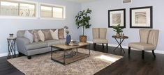 Living room staged with gray linen sofa, linen accent chairs, custom wall art and reclaimed wood tables with iron base. Linen Sofa, Wood Tables, Local Real Estate, Custom Wall, Staging, Vignettes, Accent Chairs, Dining Table, Iron