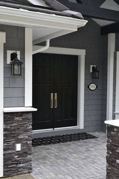 LOVE the black painted double front door. Painted shingles are Chelsea Gray by … LOVE the black painted double front door. Painted shingles are Chelsea Gray by Benjamin Moore. White trim and dark charcoal ledgestone. Chelsea Gray, Black Front Doors, Red Doors, Black Garage Doors, Double Front Entry Doors, Door Entry, House Paint Exterior, Home Exterior Colors, Exterior Siding