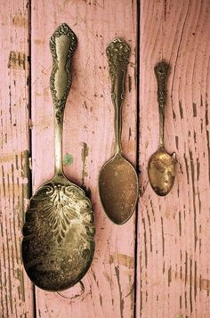 Love the patina on these tarnished silver pieces....as well as the scruffy pink boards behind.  Perfection!