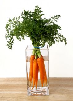 Carrots in a Vase -     Another way to be creative with your party decor is to fill some vases with veggies instead of flowers.
