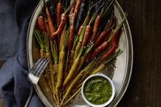 colorful side dish of Charred Carrots topped with a basil mint vinaigrette