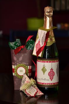 """Wine bottle wrapper with coordinating tag, box-in-a-bag and twisted sour cream container (from Christmas """"Card"""" Class). All projects made with Stampin' Up! supplies."""