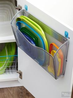 Keep your kitchen organised with this easy storage trick - pop a basket on the back of a door to hold container lids - genius!