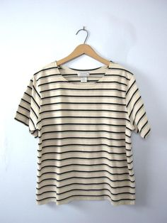One vintage 1990s black and beige striped top, striped tee, womens size Large  - Scoop neckline. - Horizontal stripes. - Fabric stretches to fit. - Shorter length in the torso. - Color scheme: light beige and black.  | CONDITION | A+. Gently used vintage item.  | BRAND | Jennifer Moore. Made in Egypt.  | SIZE | Marked as a womens Large (USA). *** PLEASE compare the measurements below to a similar item that fits you for the best sizing! ***  ~ Garment laying flat. Double measurements where…