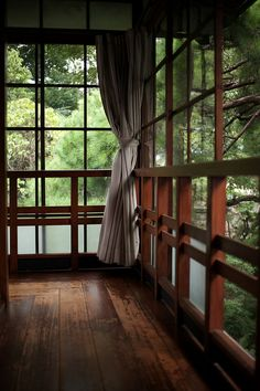 Porch. Wood tones, windows, and setting