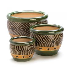 """JADE PLANTER TRIO Lush shades of sand and jade add natural elegance to your favorite plants, showing them off to stunning effect! Coordinating pots in three separate sizes create an effortless designer look. Drain hole at bottom of each pot. Large: 12"""" x 12"""" x 8 1/2"""" high; Medium: 8 3/4"""" x 8 3/4"""" x 6 1/2"""" high; Small: 6 3/8"""" x 6 3/8"""" x 4 3/4"""" high.  Materials: CERAMIC"""