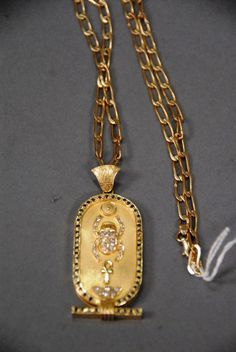 a61c0b260 Realized Price: $2,530.00~ 18k - 20k gold chain with large Egyptian style  pendant set with 54 emeralds and 26 diamonds, length of chain, 24 1/2
