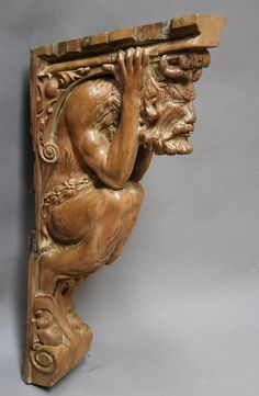 Superb large carved pine bracket in the form of a satyr