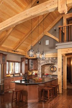 See the beautiful kitchens and dining rooms constructed by Riverbend Timber Framing. Find inspiration for designing your own custom rooms in your timber frame home. Timber Frame Cabin, Timber House, Timber Frames, Metal Building Homes, Building A House, Plan Chalet, Log Home Kitchens, Mountain Home Exterior, Cabin In The Woods