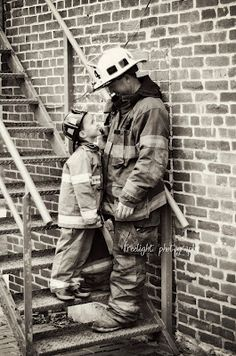 love this shot of a firefighter and his son.  from the looks of it, he wants to follow in daddy's footsteps.