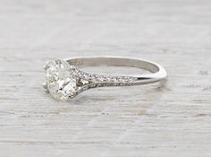 Art Deco ring made in platinum and centered with a 1.61 carat GIA certified old European cut diamond with J color and VVS2 clarity. Accented with two marquise cut diamond and one single cut diamond on