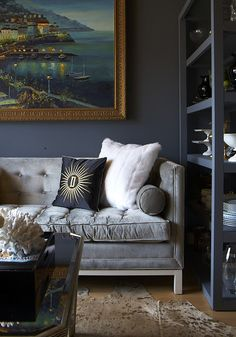 Adore the sofa but lose the pillows and the painting. And the over-exposed animal hide.