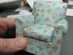 Make and upholstery a miniature armchair from foam core and fabric.