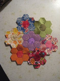 English Paper Piecing--- I would love to have a quilt like this with that green and orange a little bit of yellow and brown too!