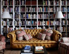 Chesterfield sofas just seem to be right at home among books.