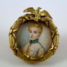 """Antique French Pinchbeck Portrait Miniature Pin, Brooch Of Napoleon II, """"L'Aiglon"""" """"The Eaglet"""" After the fall of Bonaparte, he and his mother, the Empress Marie Louise, nee Archduchess of Austria, lived at the court of his grandfather the Emperor of Austria. Called the Duke of Reichstadt. Died young, w/out issue, tho rumors circulated of his intimacy with Archduchess Sophie, the mother of Franz Josef."""