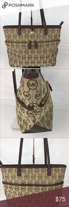 Michael Kors Tote Super cute gently used. Michael Kors tote. Please see strap for only sign of wear Michael Kors Bags