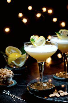 Sidecar Fizz Cocktail.     1 egg white  3/4 oz fresh Lemon Juice. 1 1/2 oz Cognac. 3/4 oz Cointreau. 1/2 oz Simple Syrup (optional). Splash of club soda. Combine egg white and lemon juice in a cocktail shaker.  Shake. Add cognac, cointreau, and optional simple syrup. Fill with ice and shake. Strain into a glass.  Add a splash of club soda and garnish.