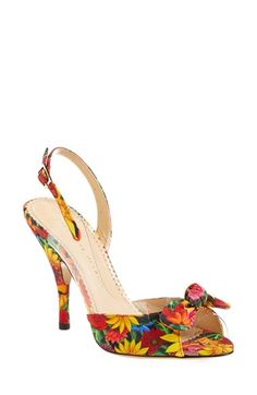 Free shipping and returns on Charlotte Olympia 'Sue' Floral Print Sandal (Women) at Nordstrom.com. Take your shoe collection south of the border with Charlotte Olympia's uber-feminine Sue sandal. The curvaceous, bow-topped silhouette is done up in a fiercely colorful Frida Kahlo print, a vibrant example of the collection's spotlight on Mexico.