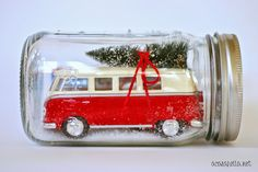 Package gift cards in a mason jar with a car (or bus).