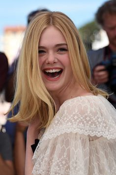 """Elle Fanning Photos - US actress Elle Fanning smiles on May 20, 2016 during a photocall for the film """"The Neon Demon"""" at the 69th Cannes Film Festival in Cannes, southern France.  / AFP / ANNE-CHRISTINE POUJOULAT - 'The Neon Demon' Photocall - The 69th Annual Cannes Film Festival"""