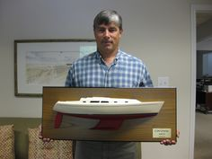 """* 24"""" half hull model of the Sabre 386 with shoal wing keel.  The model is mounted on the Teak backboard.  The size of the backboard is 30"""" x 12"""". The model weight is 11 LBS. The model scale is 1/19.      ----   Please visit the web at www.halfhull.net or contact Mas at halfhull@gmail.com for more model information.   ----   Zuma Boat   (404) 272-7889."""
