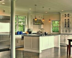 Eclectic Kitchen Glass Cabinets.  Love everything in this kitchen.  The brick, layout, windows.  Would only add a bit of color.