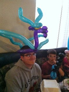 Last night was Kids eat free at the pizza joint we went too. So the three younger kids were free and the balloon guy made them cool b. Balloon Hat, Big Balloons, Balloon Flowers, Ballon Animals, Balloons Galore, Medieval Party, Balloon Modelling, Dragon Party, Baby Presents