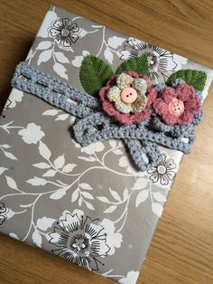 Alison Westwood (@eclipsegiftwrap) | Twitter When the ribbon runs out bring out the crochet hook instead! Silver/grey and pink with green hessian leaves. Professional Gifts, Hessian, Crochet Hooks, Wraps, Ribbon, Gift Wrapping, Leaves, Concept, Twitter