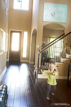 This is the exact layout of our entryway and staircase. I want mine to look more like this!