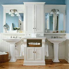 This design is also symmetrical with his and her sinks. The uniqueness of this area is that the sinks are split with the middle cabinet to give the vanity spaces privacy.  http://www.bhg.com/bathroom/type/master/master-bathroom/